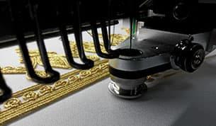 Kordelstickeinrichtung – ZSK Stickmaschinen