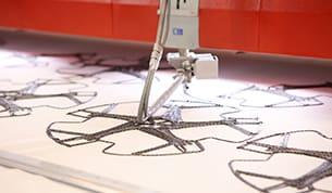 Technische Stickerei – ZSK Stickmaschinen