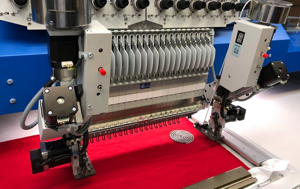 Perleneinrichtung – ZSK Stickmaschinen